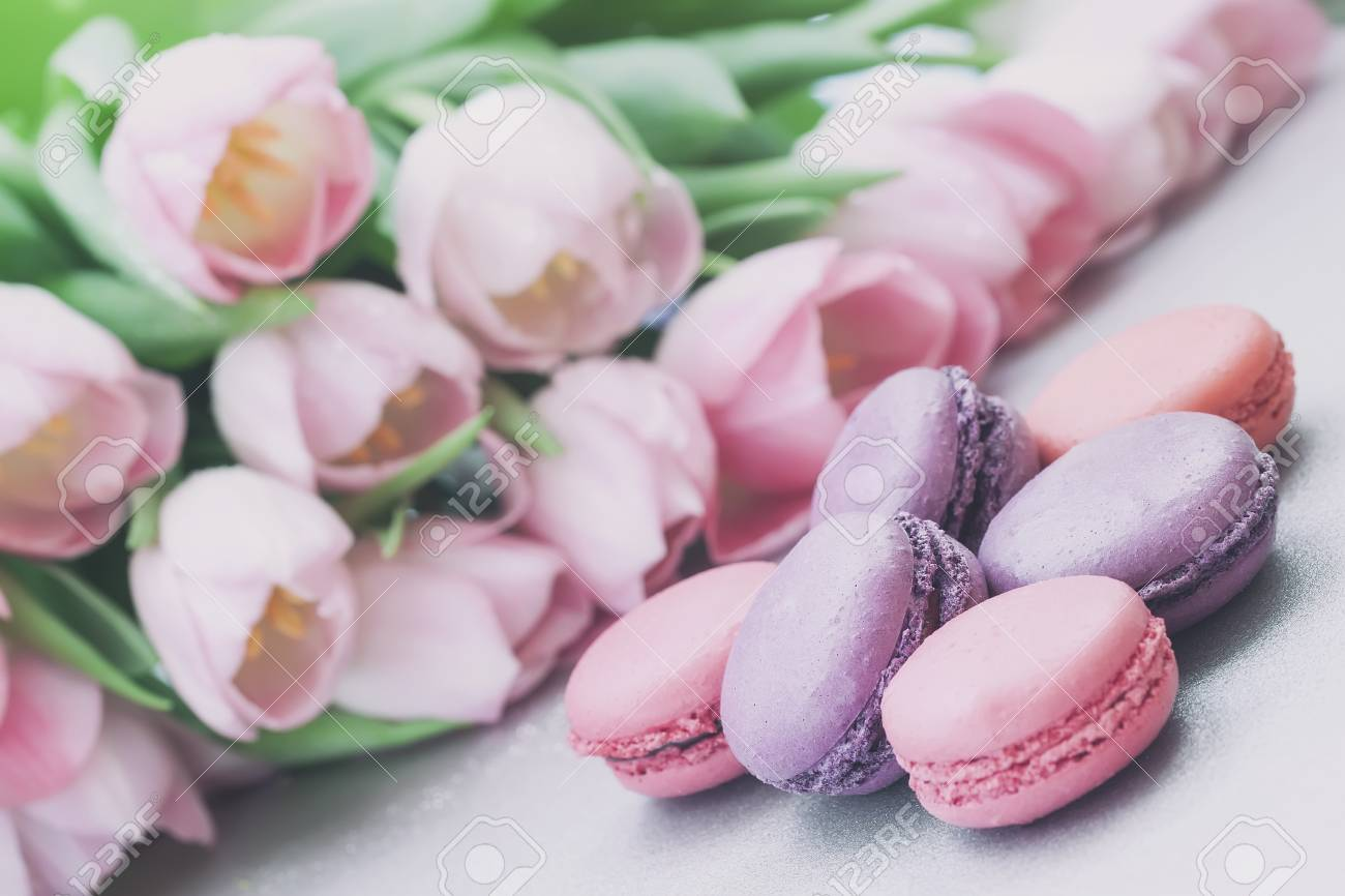 Pink and violet macaroons spring flowers tulips tender pastel pink and violet macaroons spring flowers tulips tender pastel background romantic morning negle Choice Image