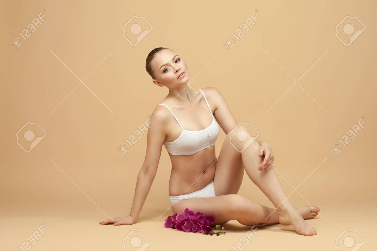 5b8e14bd4262 beautiful woman in underwear sitting on the floor, perfect figure Stock  Photo - 35465416