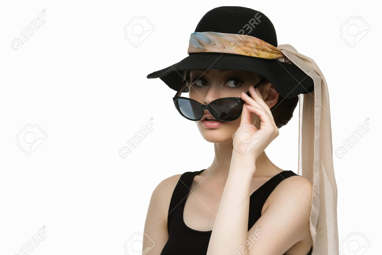 44e6cc5326758 Beautiful young woman looking like Audrey Hepburn in hat with scarf and  sunglasses Stock Photo -