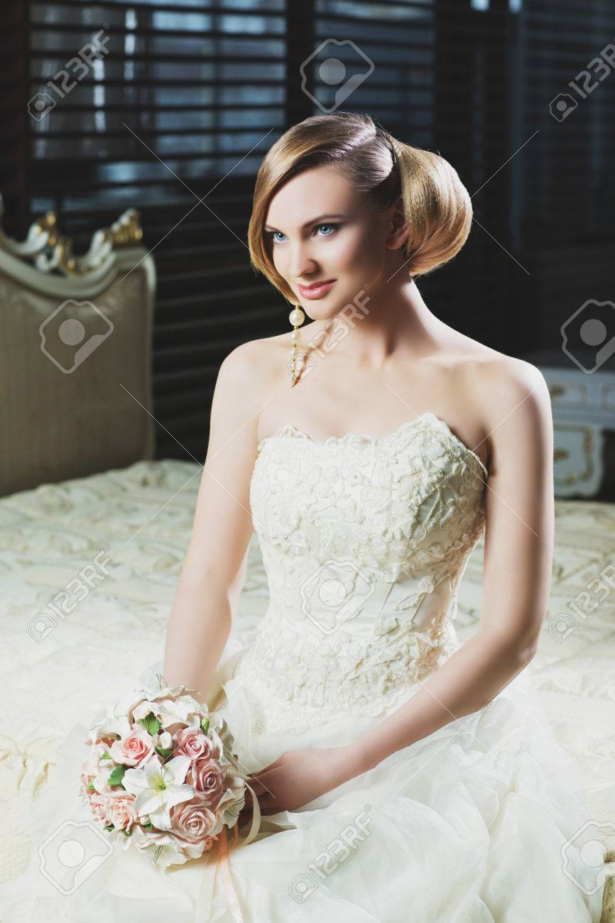 Beautiful Young Bride With Makeup And Fancy Hairstyle In Fancy Dress ...