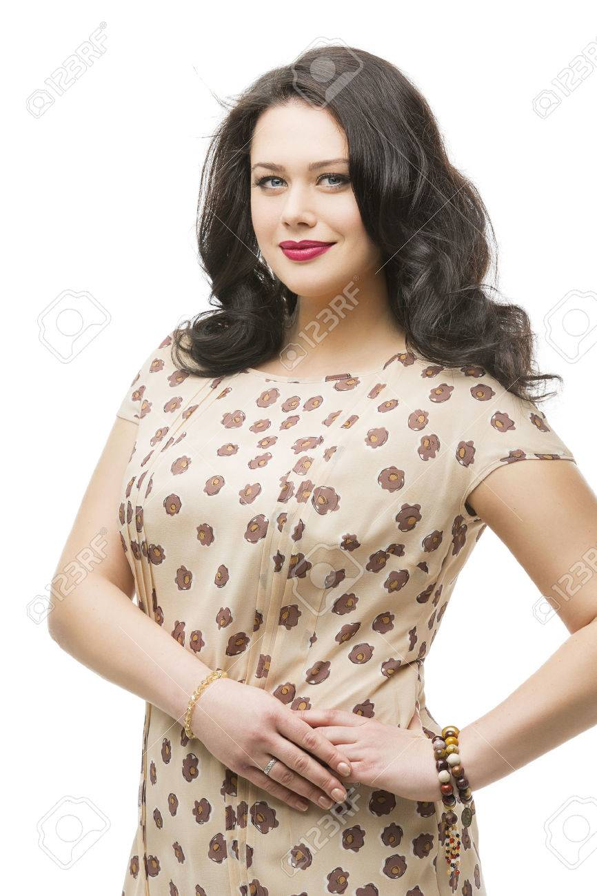 Beautiful plus size young woman with makeup and red lips wearing long dress. Isolated over white background. - 43461022