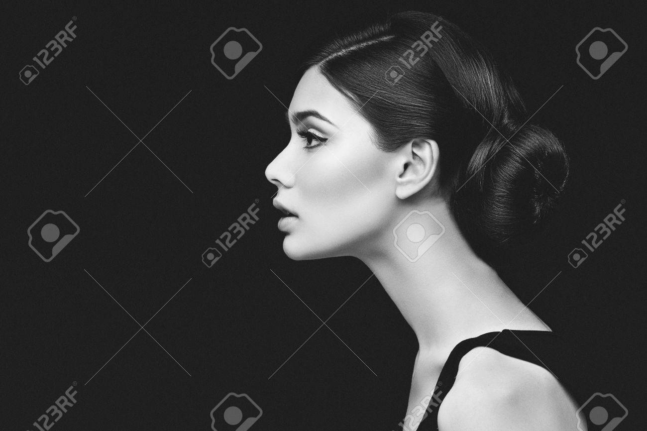Closeup shot of beautiful young woman profile over black background - 43549905