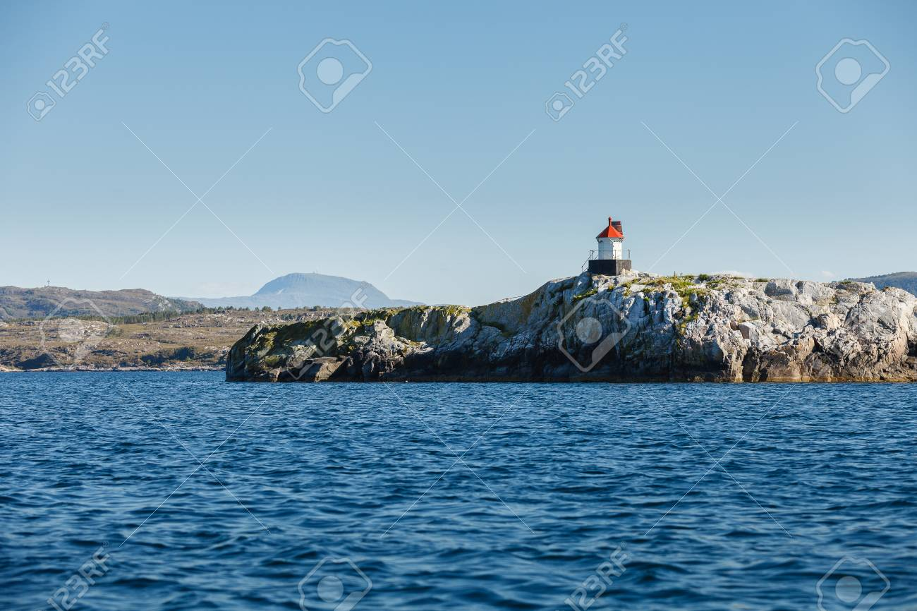Beautiful View On Norwegian Fjords With Small Lighthouse On Island ...