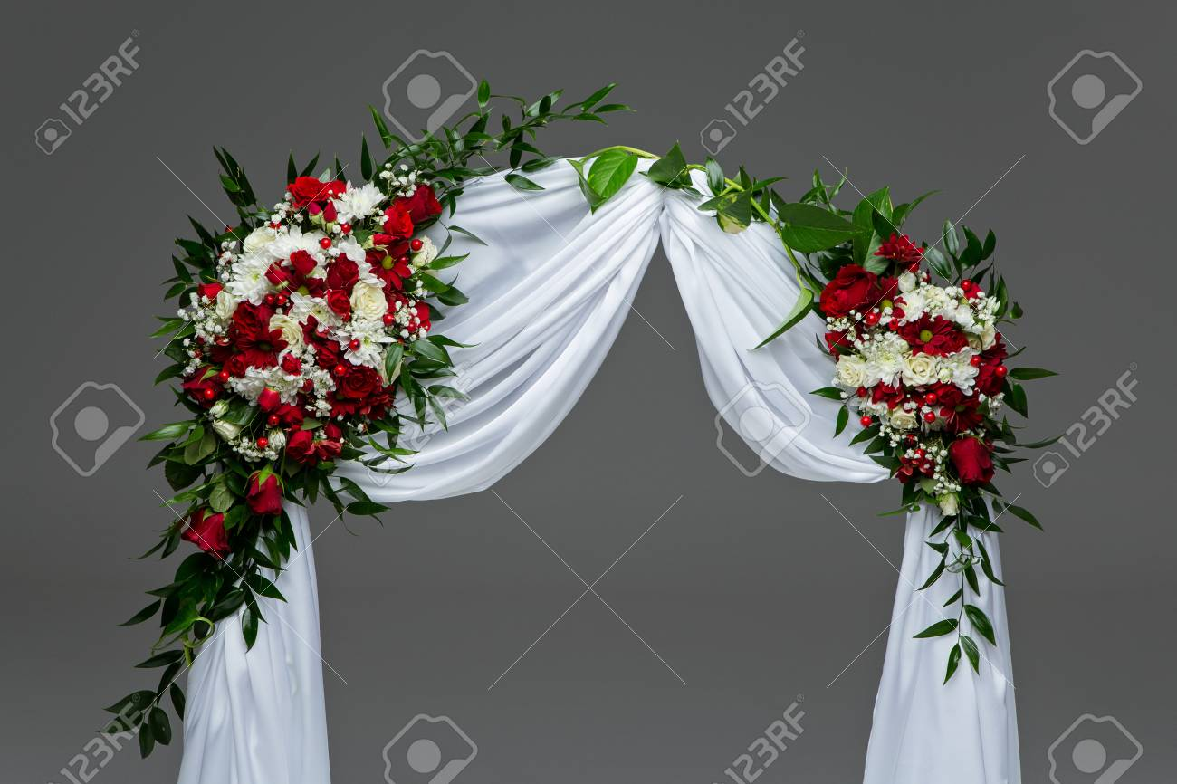 beautiful roses flower arch wedding decoration with red and white..