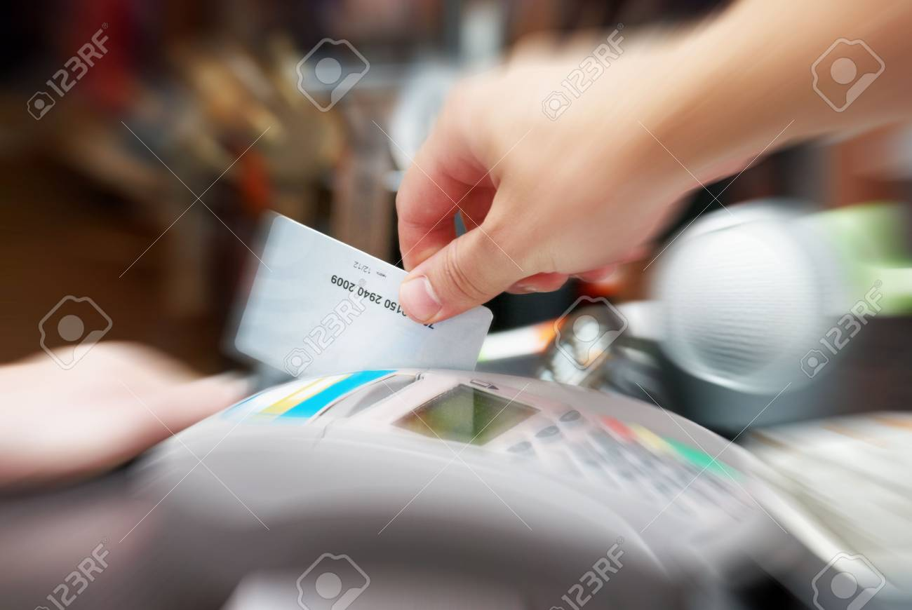 seller hold in his hand a credit card Stock Photo - 5860938