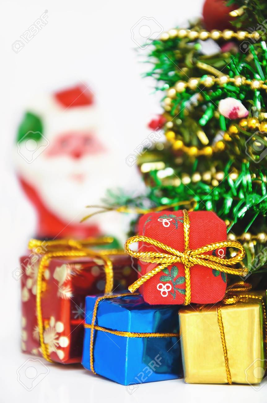close up of decorated christmas tree with many presents on green background with copy space on right Stock Photo - 8257919