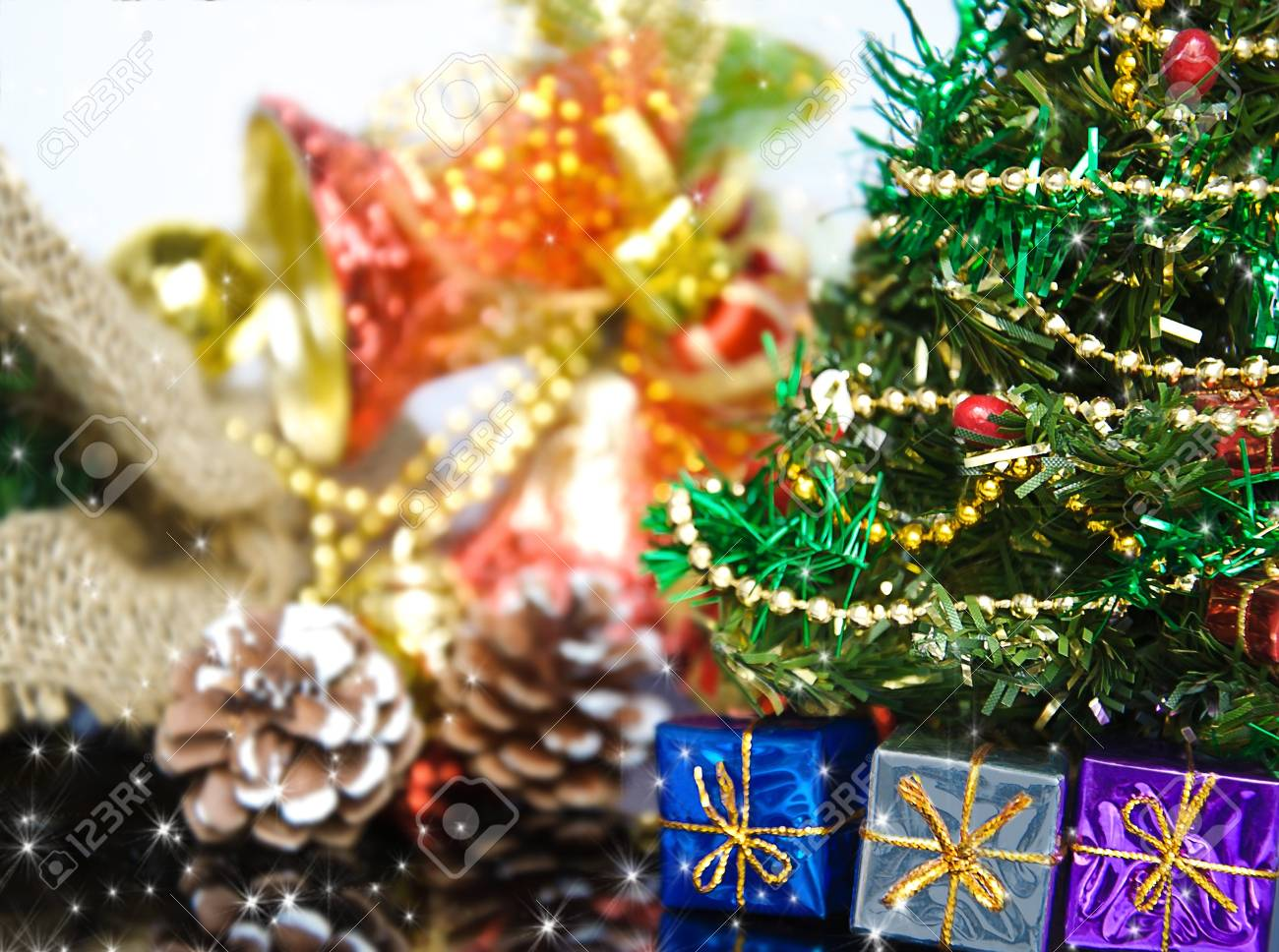 close up of decorated christmas tree with many presents on green background with copy space on right Stock Photo - 8257968