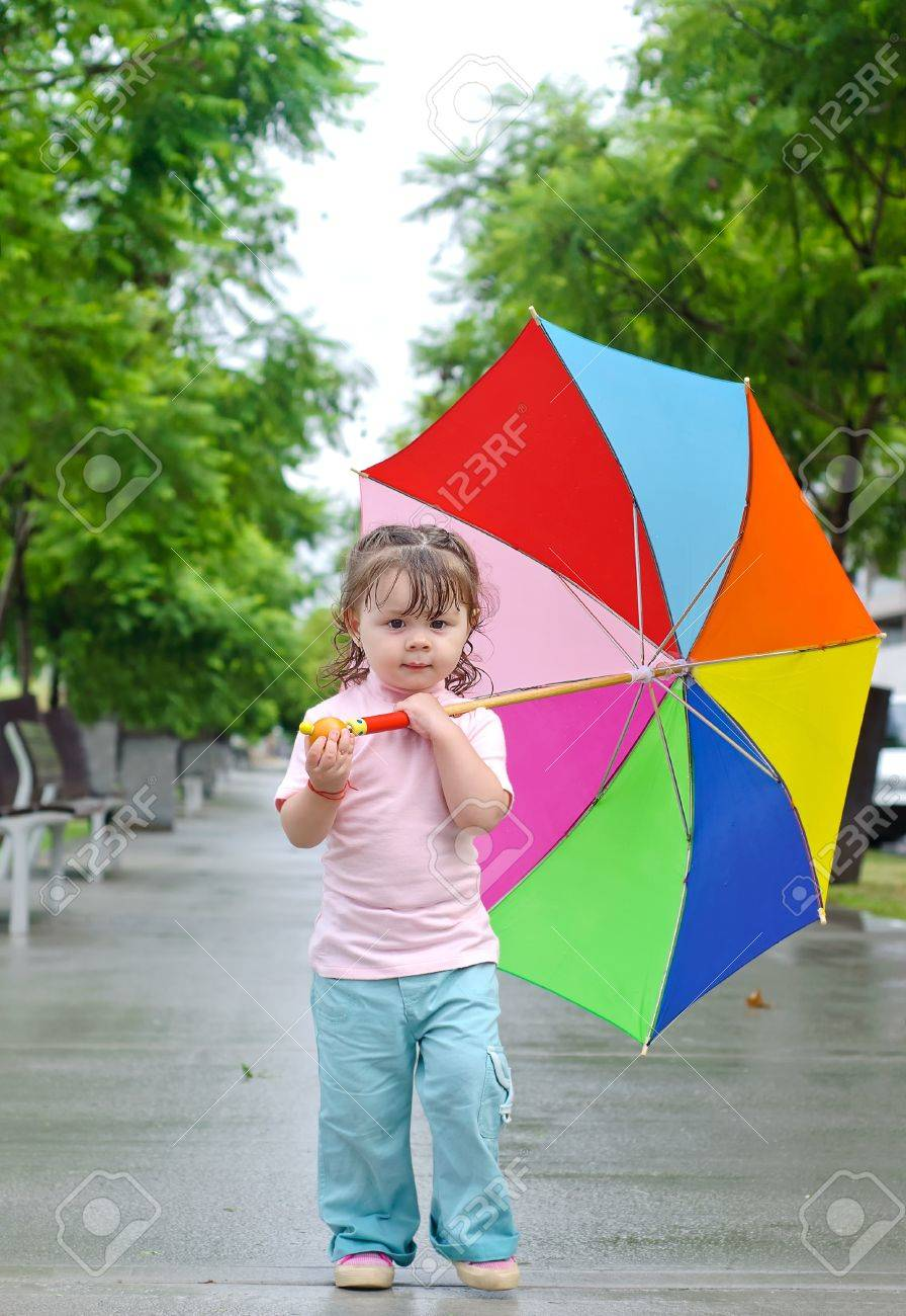 Adorable Toddler Girl With Colorful Umbrella Outdoors At Autumn ...