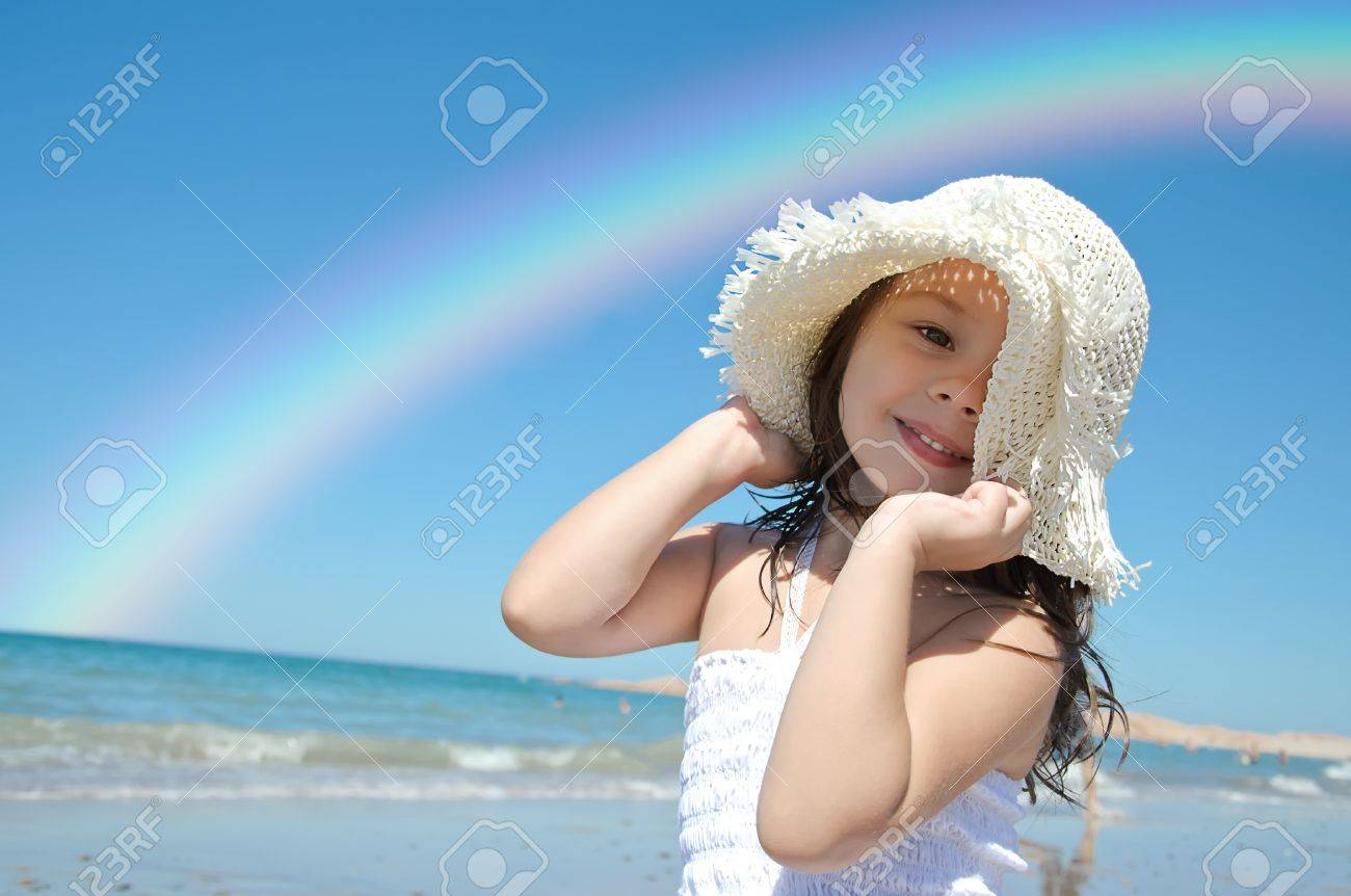 Little girl on the beach wearing funny hat. Stock Photo - 11780978
