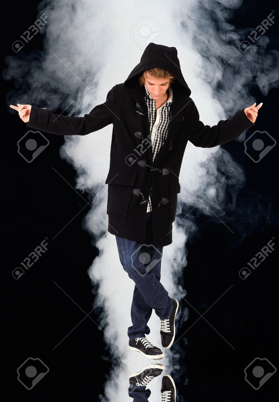 A hooded man with red lips on black smoke background Stock Photo - 11781173