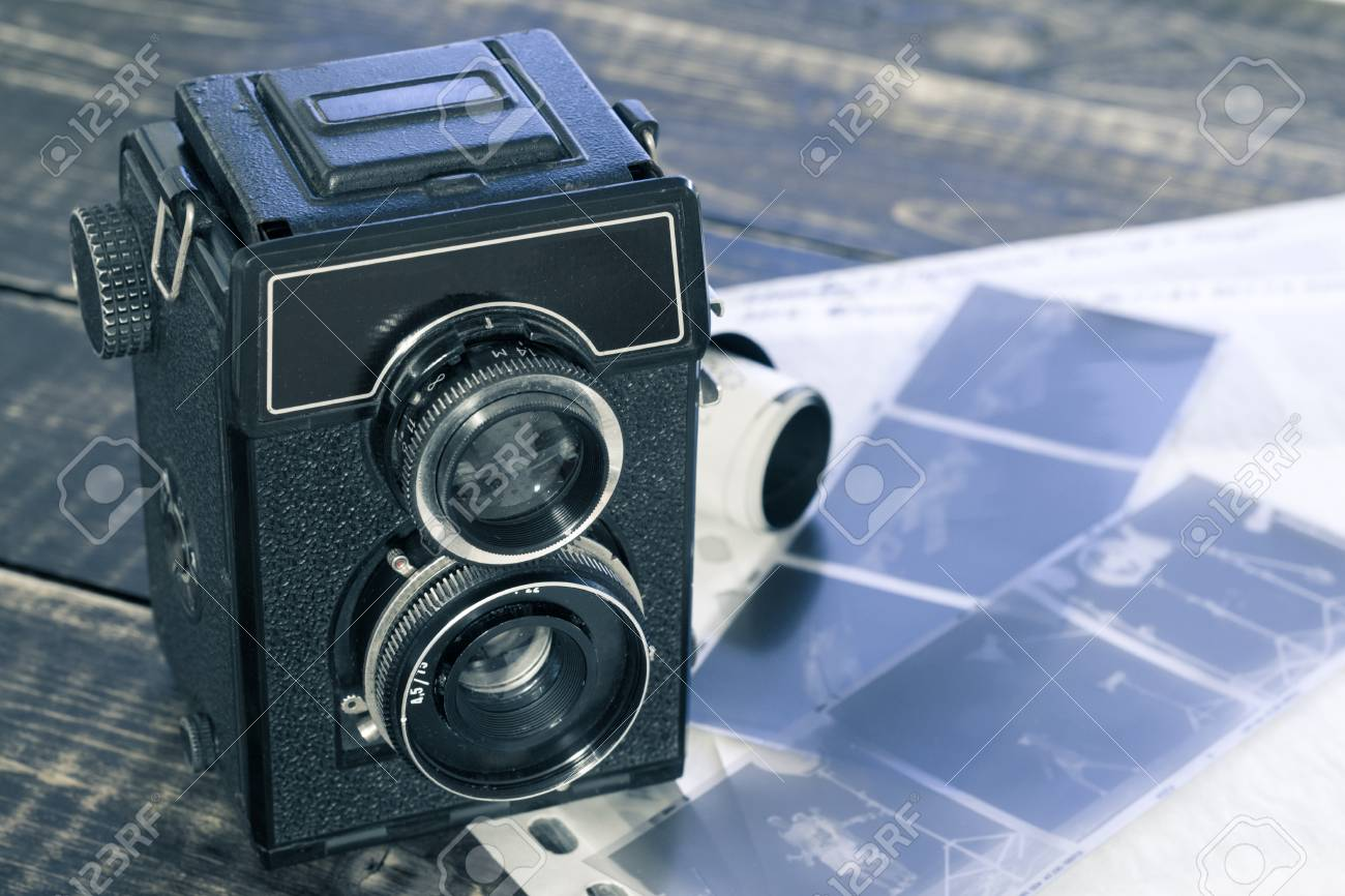 Old film camera and black and white negative film 120mm stock photo 95259748