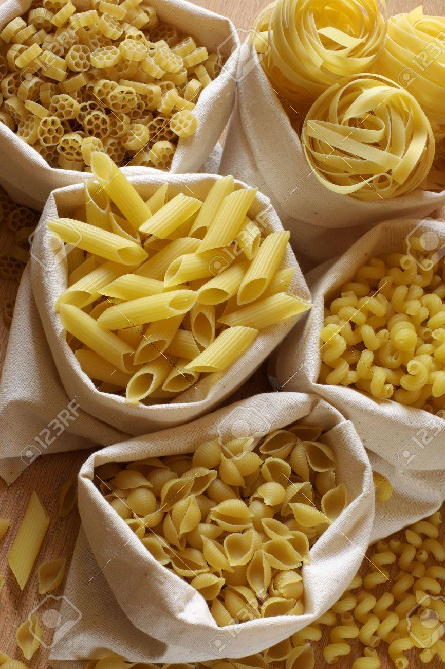 Various raw shaped pasta in textile bags. Stock Photo - 4849089