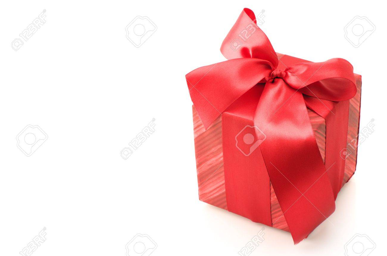 Red gift with satin bows isolated on white background. Stock Photo - 6024540