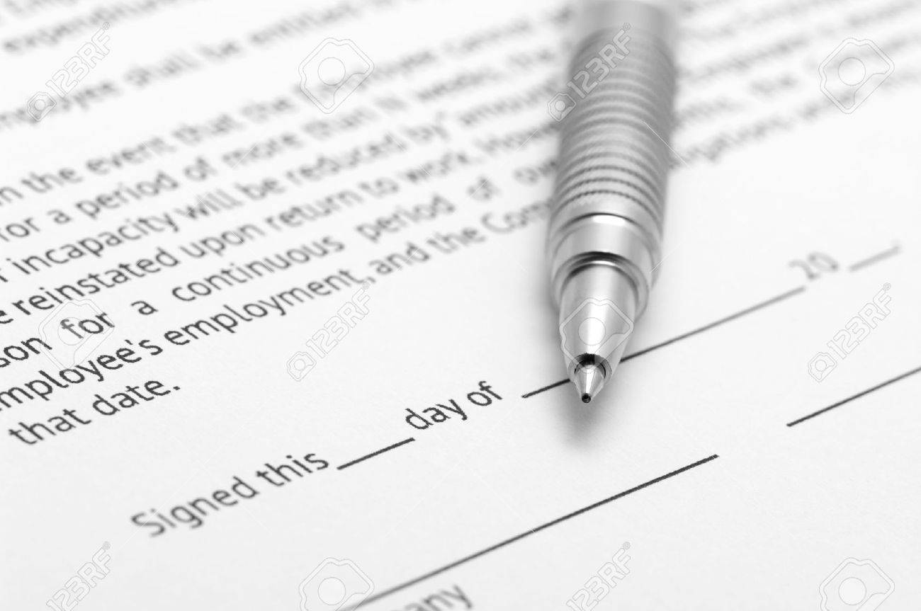 Close-up of silver pen on employment agreement. Selective focus on top of pen. Stock Photo - 6507713