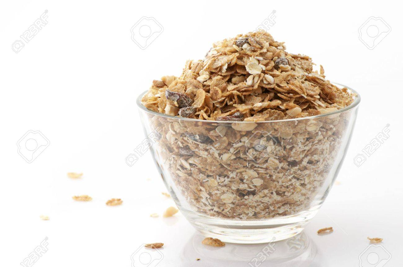 Glass bowl with muesli isolated on white background. Stock Photo - 6872237