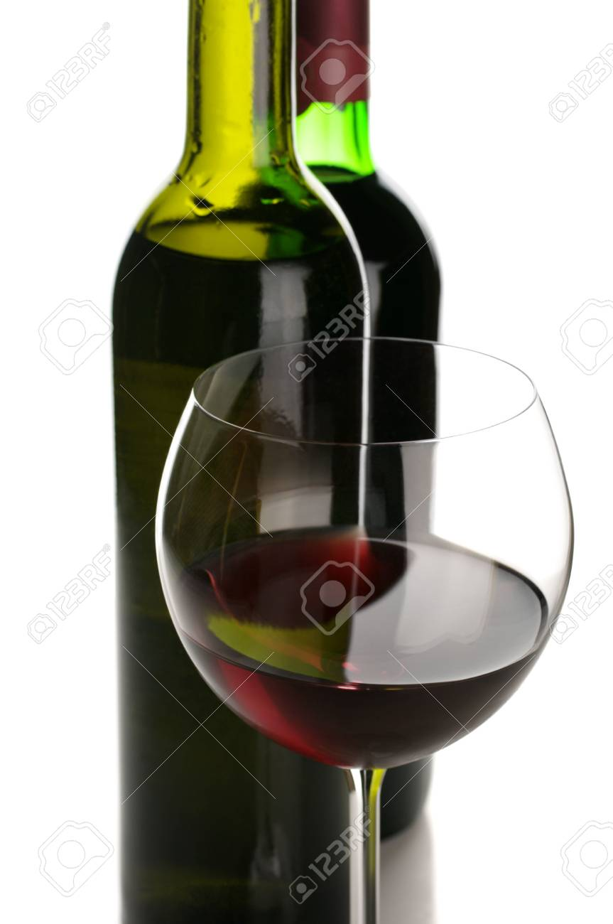 Two bottles and glass of red wine close-up on white background. Stock Photo - 7661302