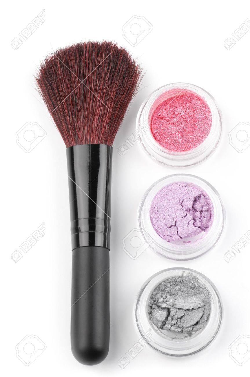 Make-up brush and powder eye shadows in jars isolated on white background. Stock Photo - 8804401