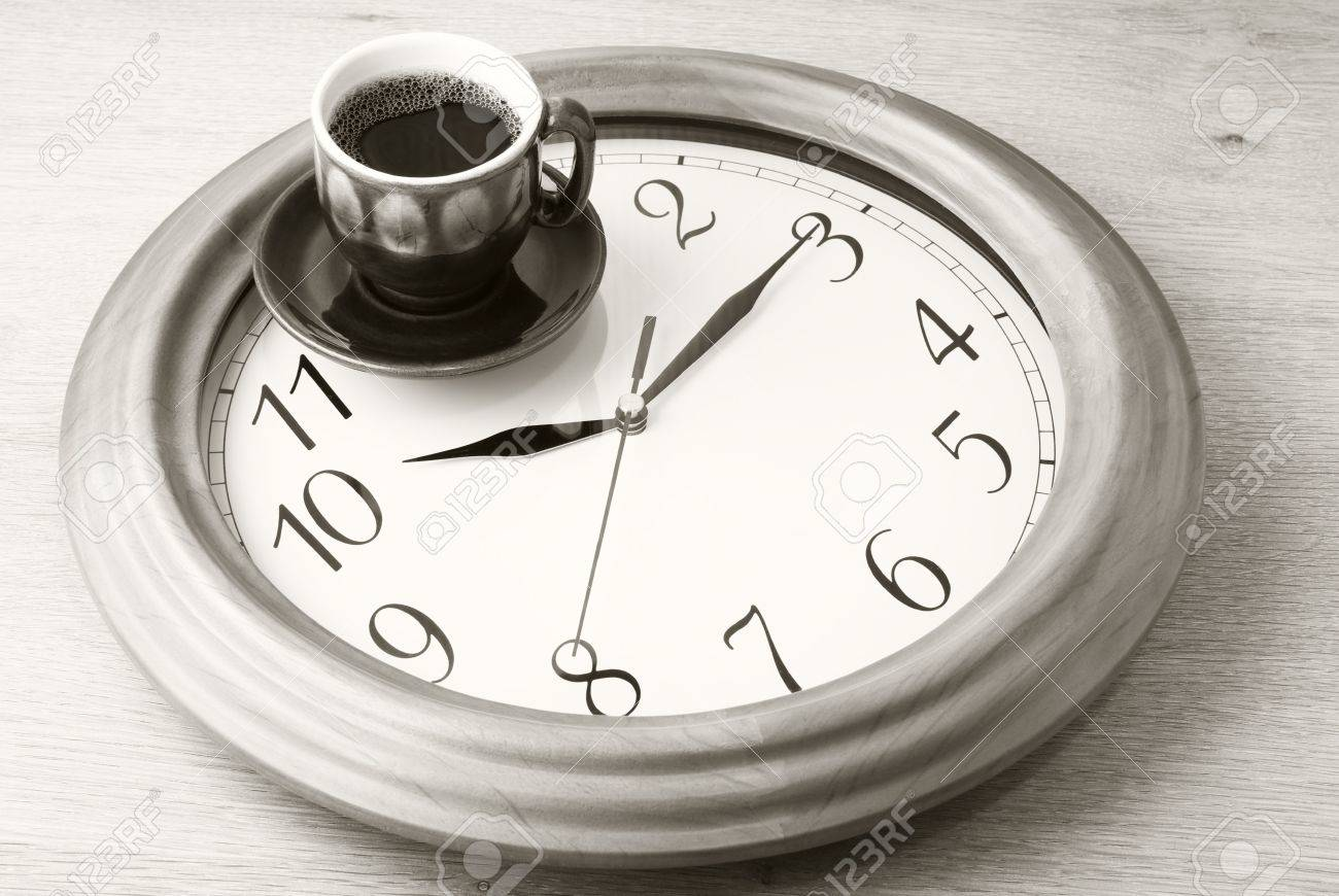 Coffee time: cup of coffee on clock dial. Sepia. Stock Photo - 9569499