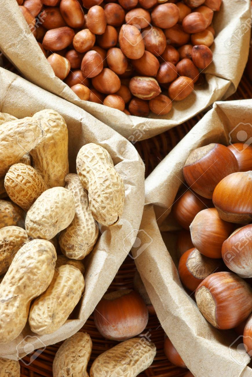 Close-up of assorted nuts in paper bags. Stock Photo - 9663362