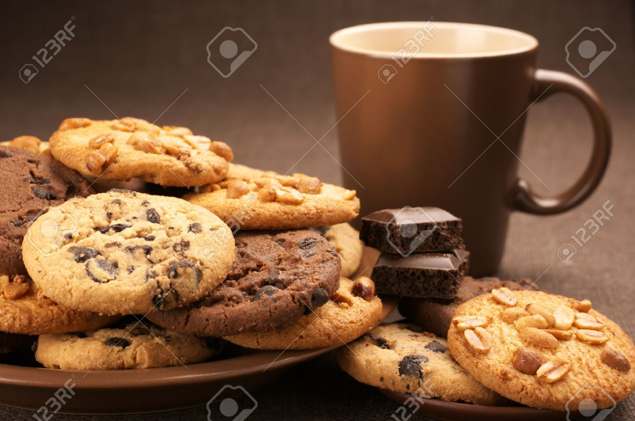 Cookie Coffee Cups Assorted Cookies In Brown Plate And Brown Mug Of Coffee On Brown
