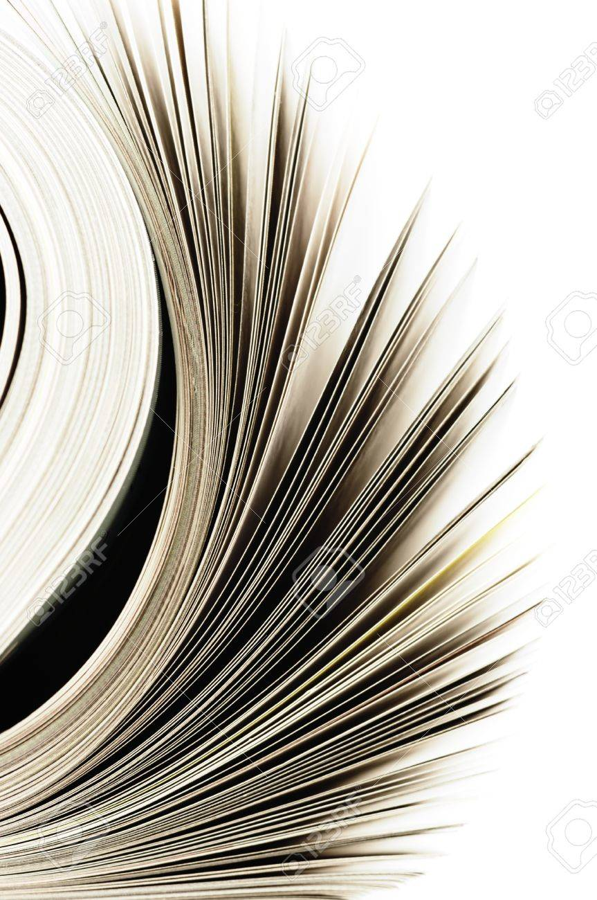 Close-up of magazine pages on white background. Shallow DOF, focus on edges. Stock Photo - 12682473