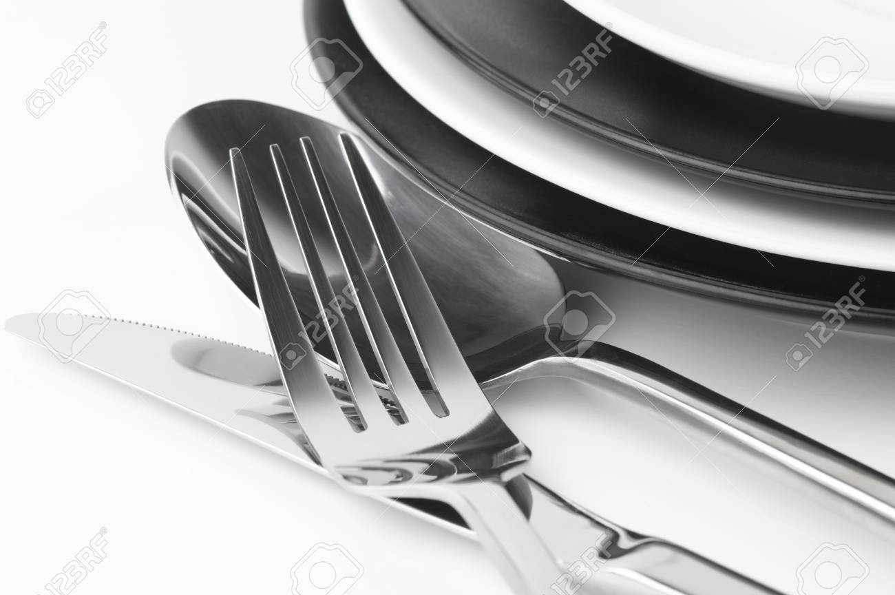Stock Photo - Table setting black and white plates and cutlery set close-up on white background. & Table Setting: Black And White Plates And Cutlery Set Close-up ...