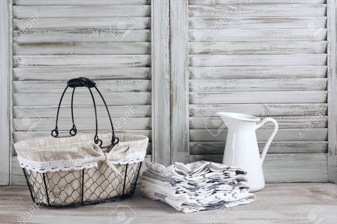 Rustic Kitchen Still Life: Wire Basket, Jug And Towels Stack.. Stock ...