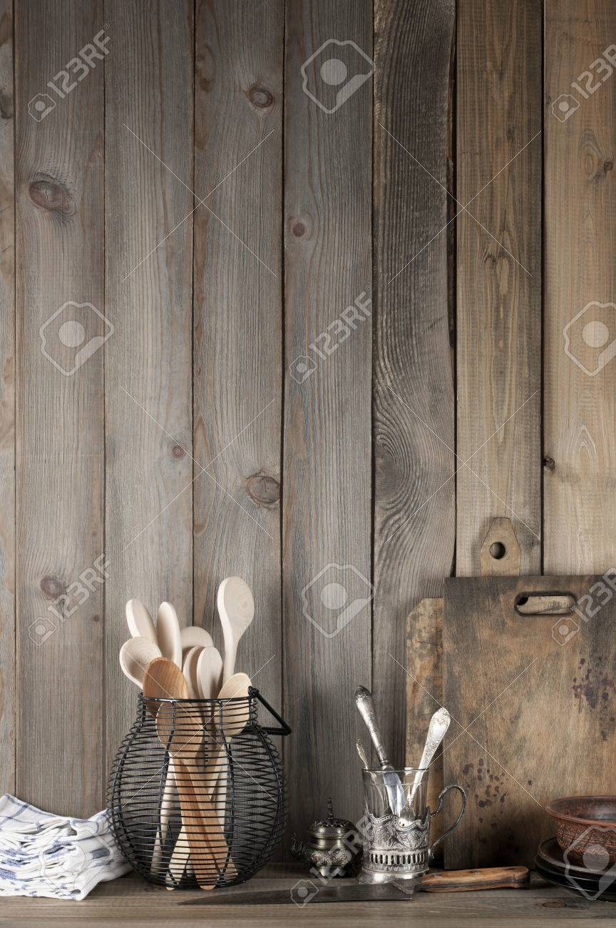 Stock Photo   Vintage Rustic Kitchen Still Life: Silver Glass Holder With  Cutlery, Wire Basket With Wood Spoons, Ceramic Dishware, Towels And Cutting  Boards ...