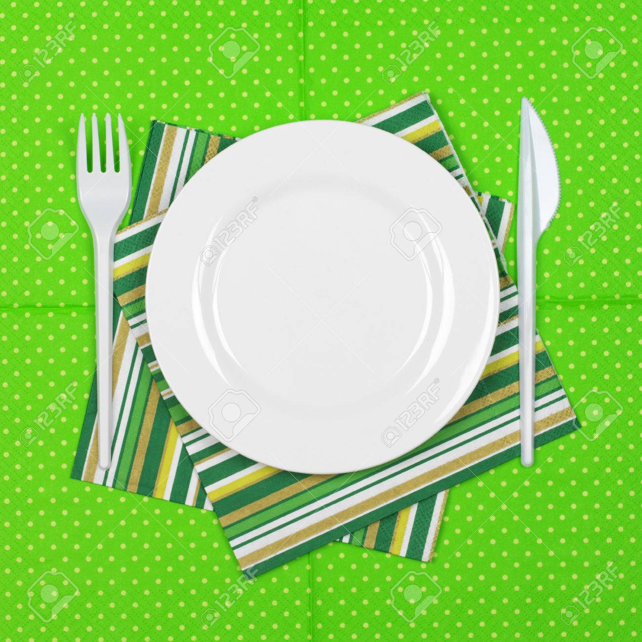 Disposable tableware set white plate with plastic fork and knife on bright green polka dot  sc 1 st  123RF.com : polka dot plastic plates - pezcame.com