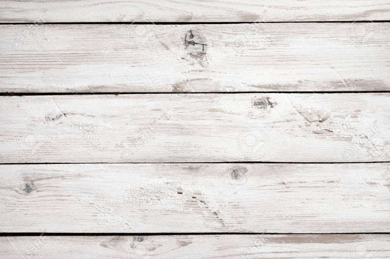 Patine Blanche Sur Bois vintage weathered shabby white painted wood texture as background.