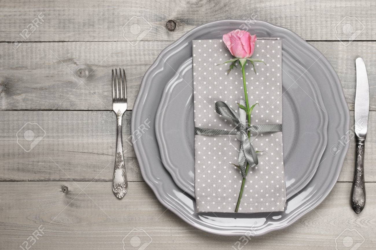Romantic table setting grey plates vintage fork and knife napkin and pink rose & Romantic Table Setting: Grey Plates Vintage Fork And Knife.. Stock ...