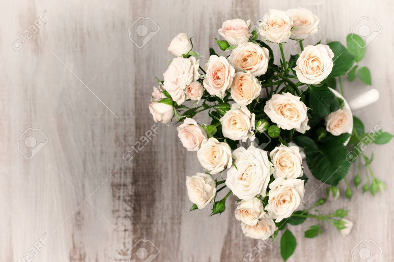 Light Pink Roses Bouquet On Rustic Wooden Table Top View Point Stock Photo Picture And Royalty Free Image Image 59927364