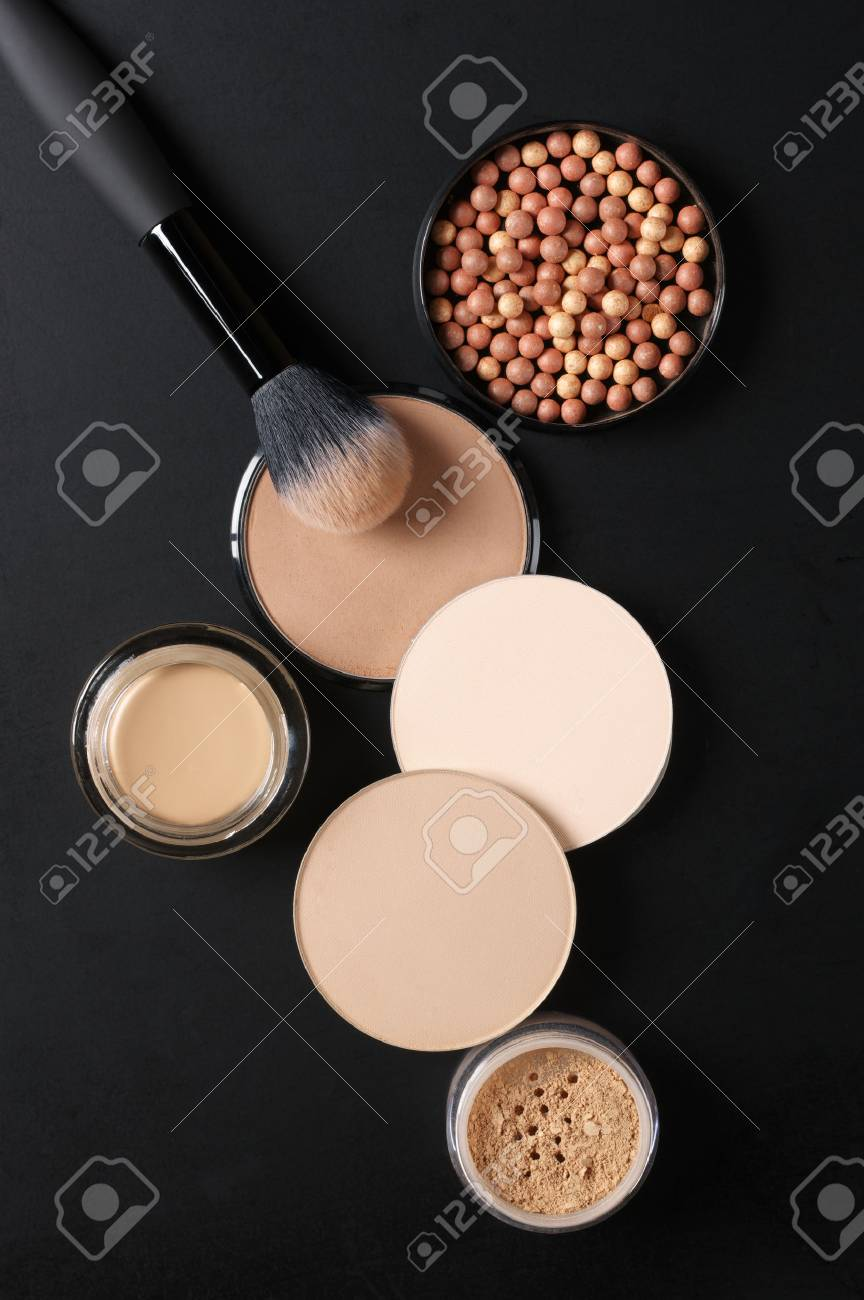 Cosmetic set of various shades compact and loose face powder, bronzed pearls, concealer and