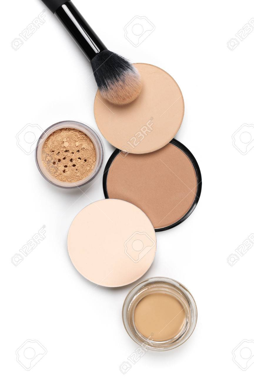 Cosmetic set of various shades compact and loose face powder and makeup brush on white background