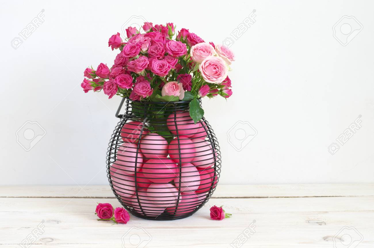 Varicolored Pink Easter Eggs In Wire Basket With Roses Bouquet ...