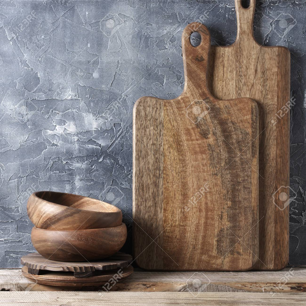Wood Bowls And Cutting Boards On Wooden Shelf Against Rough Plaster Stock Photo Picture And Royalty Free Image Image 105786167