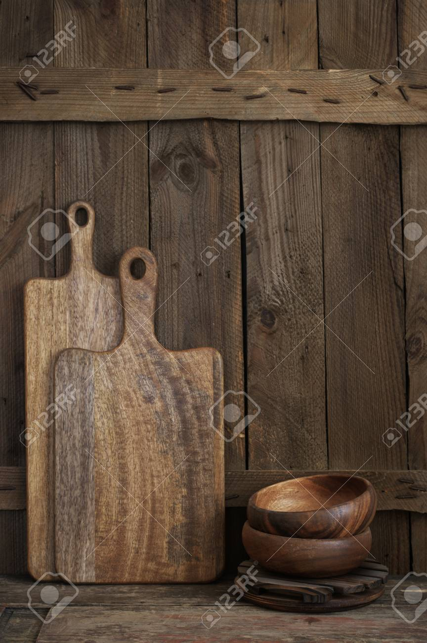 Wood Bowls And Cutting Boards On Wooden Shelf Against Rough Old Stock Photo Picture And Royalty Free Image Image 107490391