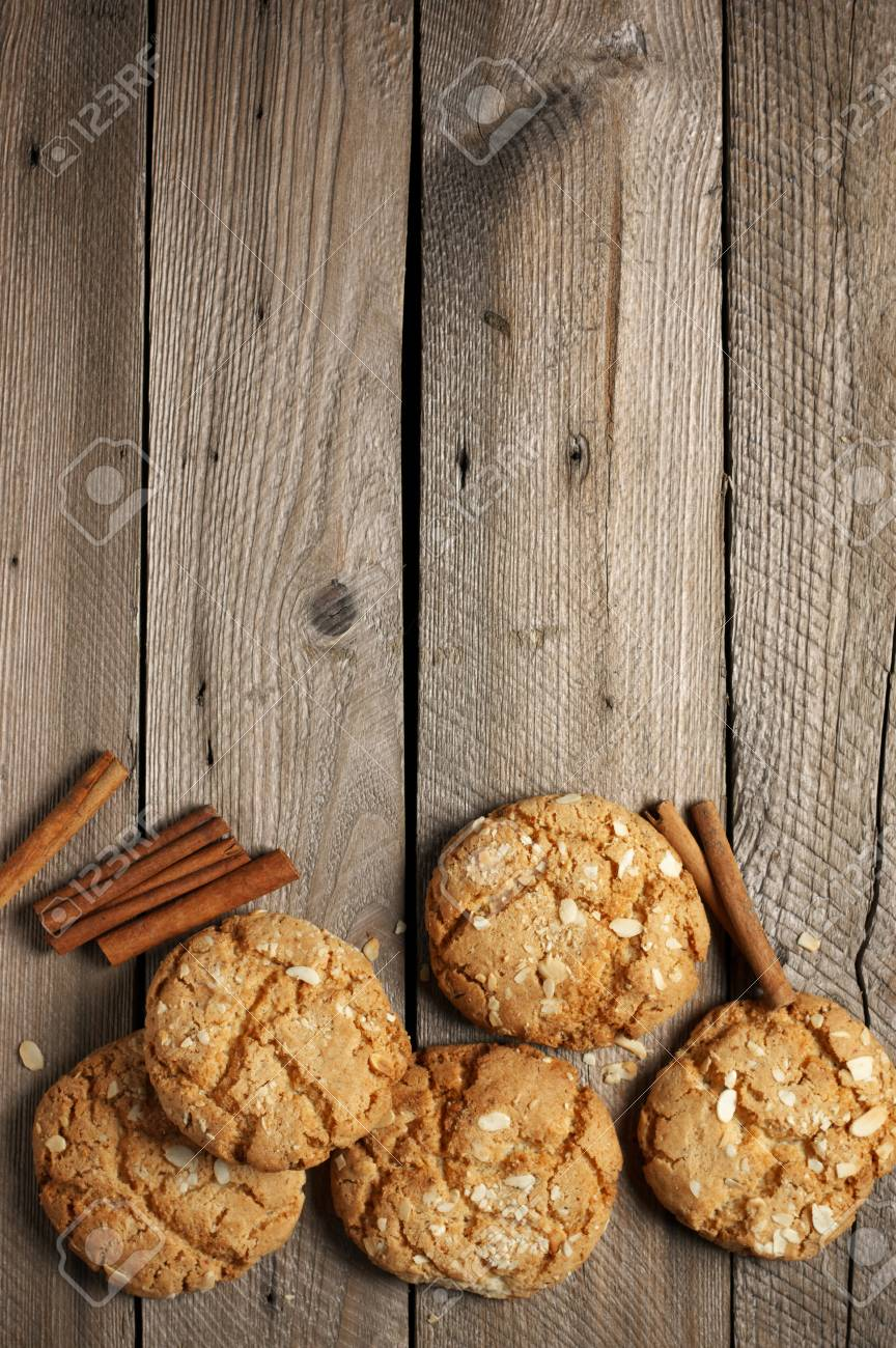 Crumbly Peanut Cookies With Cinnamon Sticks On Rustic Wooden
