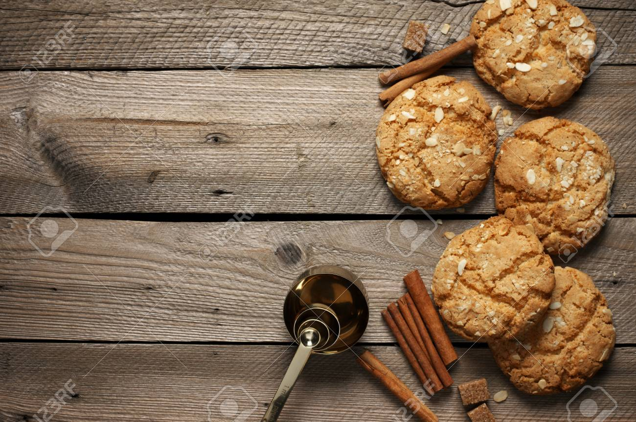 Crumbly Peanut Cookies With Cinnamon Sticks And Measuring Spoon