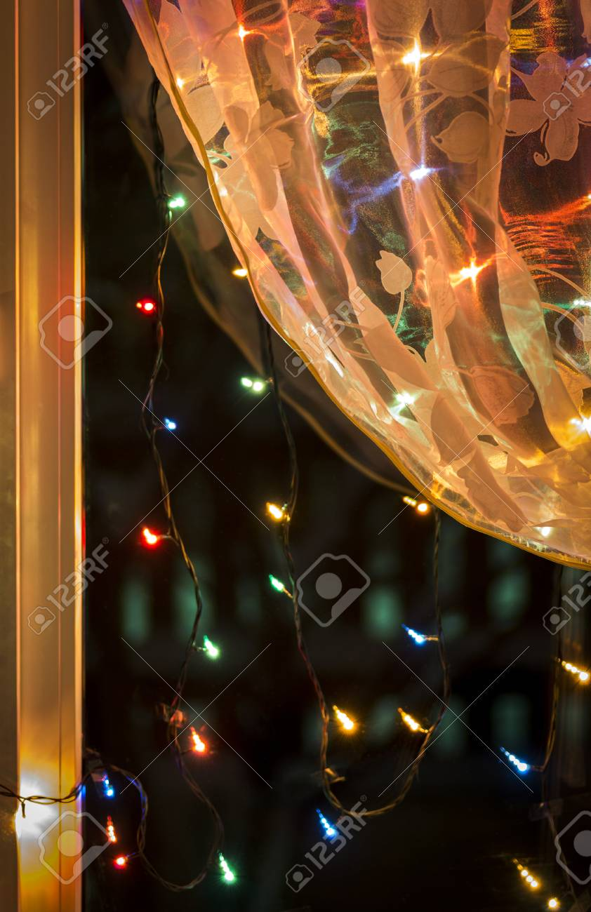 Weihnachtsbeleuchtung Am Fenster.Stock Photo