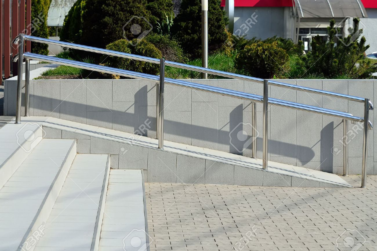 Ramp For Wheelchair Entry With Metal Handrails