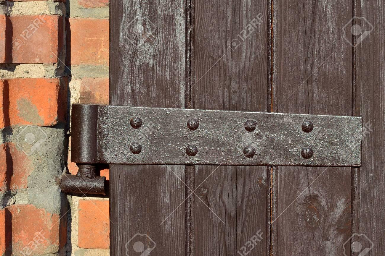 Antique Door Hinge On Wooden Door Closeup Stock Photo   51861602