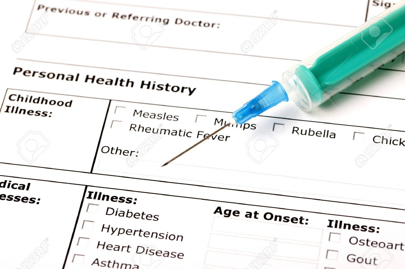 A medical history form with a green syringe Stock Photo - 9722504
