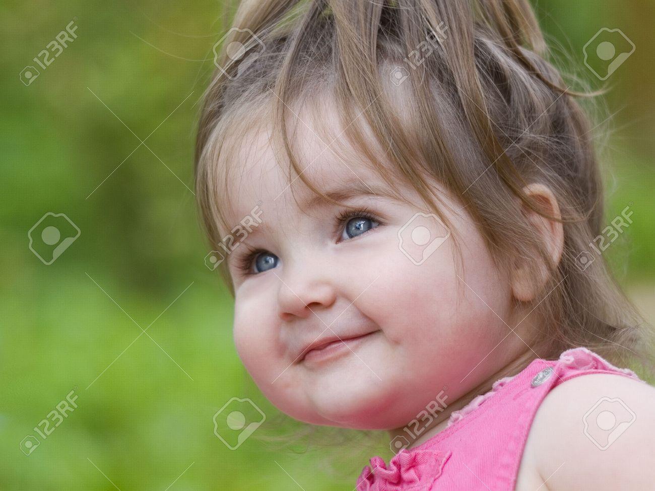Nice little girl happily smiling Stock Photo - 3487522