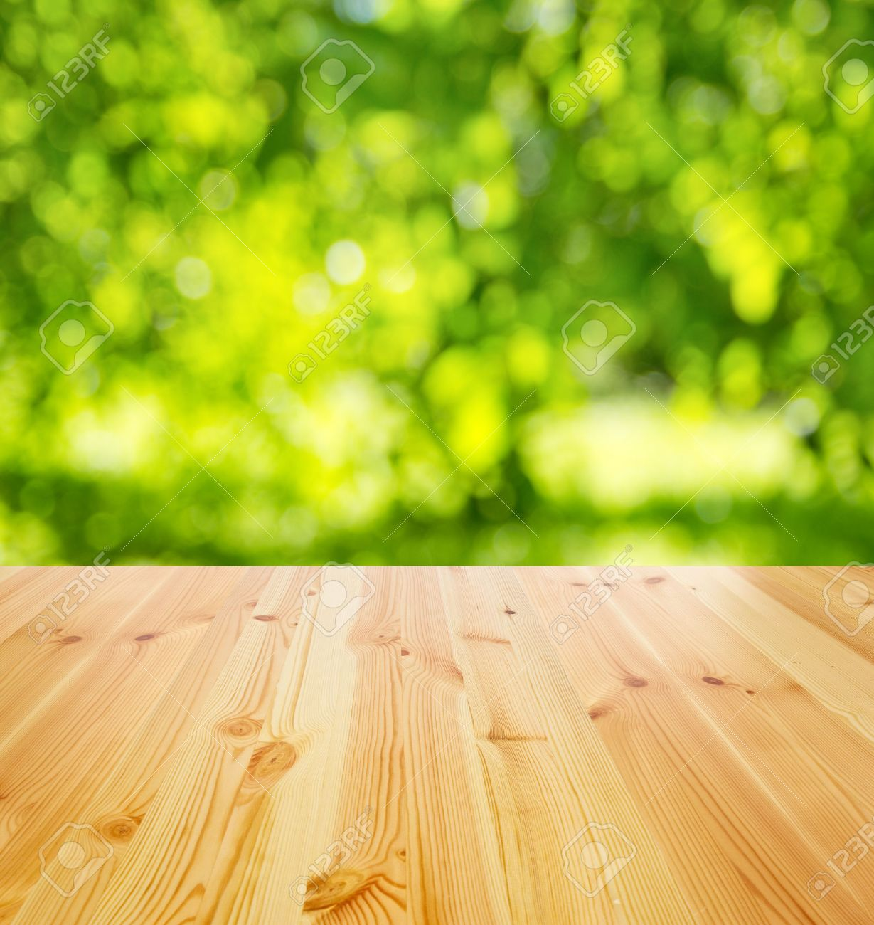 Plain wood table with hipster brick wall background stock photo - Wood Table Perspective Empty Wooden Table Against Sunny Garden For Background Stock Photo