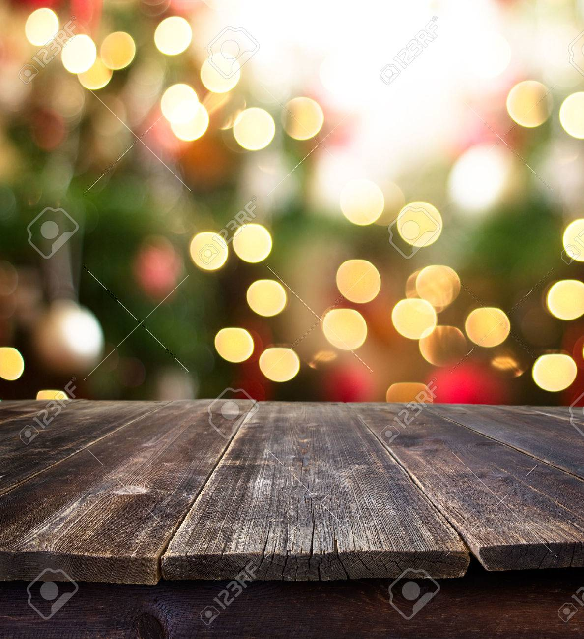 Christmas holiday background with empty rustic table over christmas bokeh for product montage - 32568886