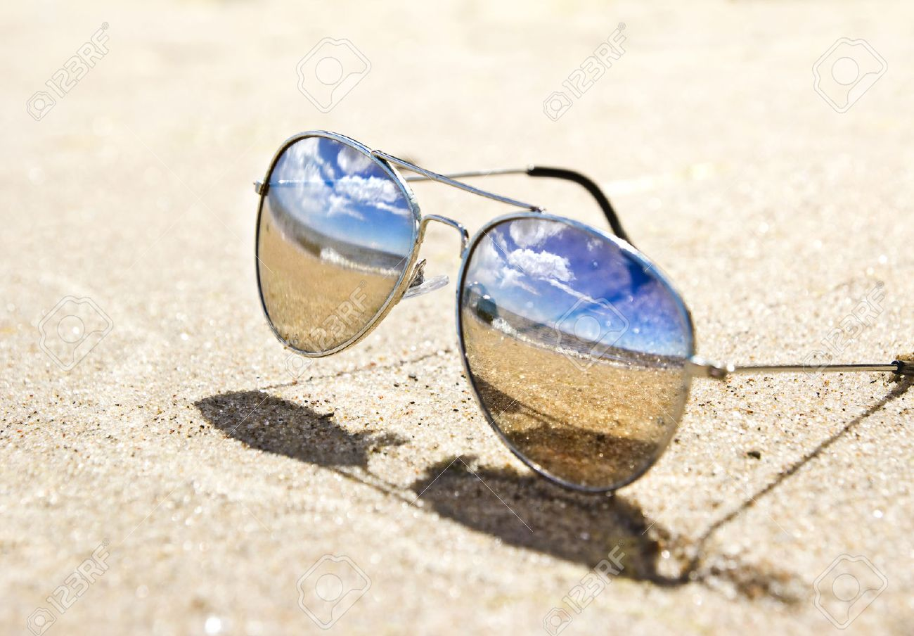 sea landscape reflecting in the sunglasses on the beach - 40227301