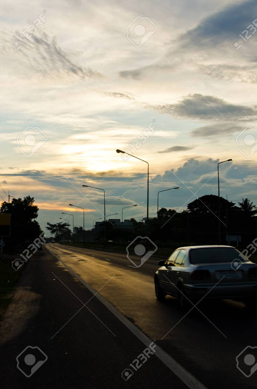 motion car on the road and bluesky in evening Stock Photo - 12814820