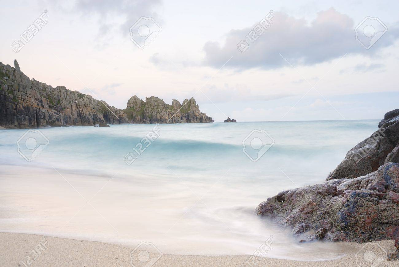 Pedn vounder beach, one of Cornwall's best beaches with stunning cliffs of Treryn Dinas, crystal clear water and a beautiful sandy beach.  On a spring low tide one can walk to Pedn Vounder from neighbouring Porthcurno beach but be warned, as the tide co Stock Photo - 10571385