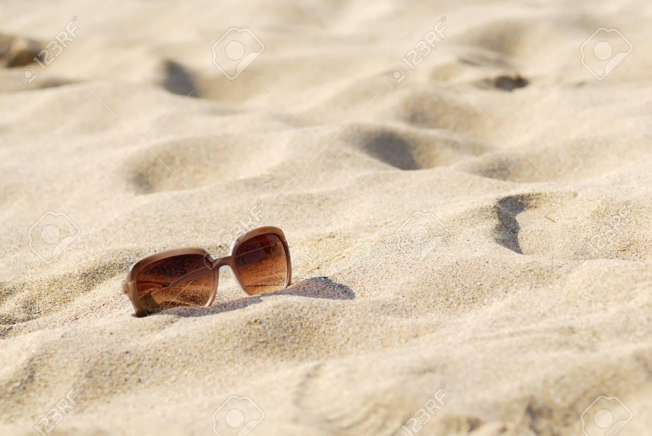 Womens sunglasses on bright sunny beach. Stock Photo - 14941943